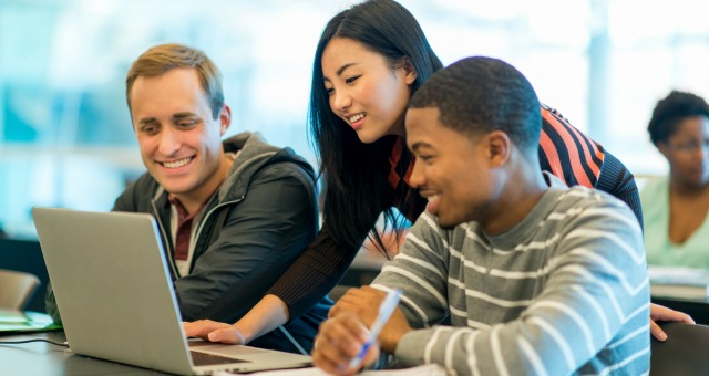 College students working together in class.