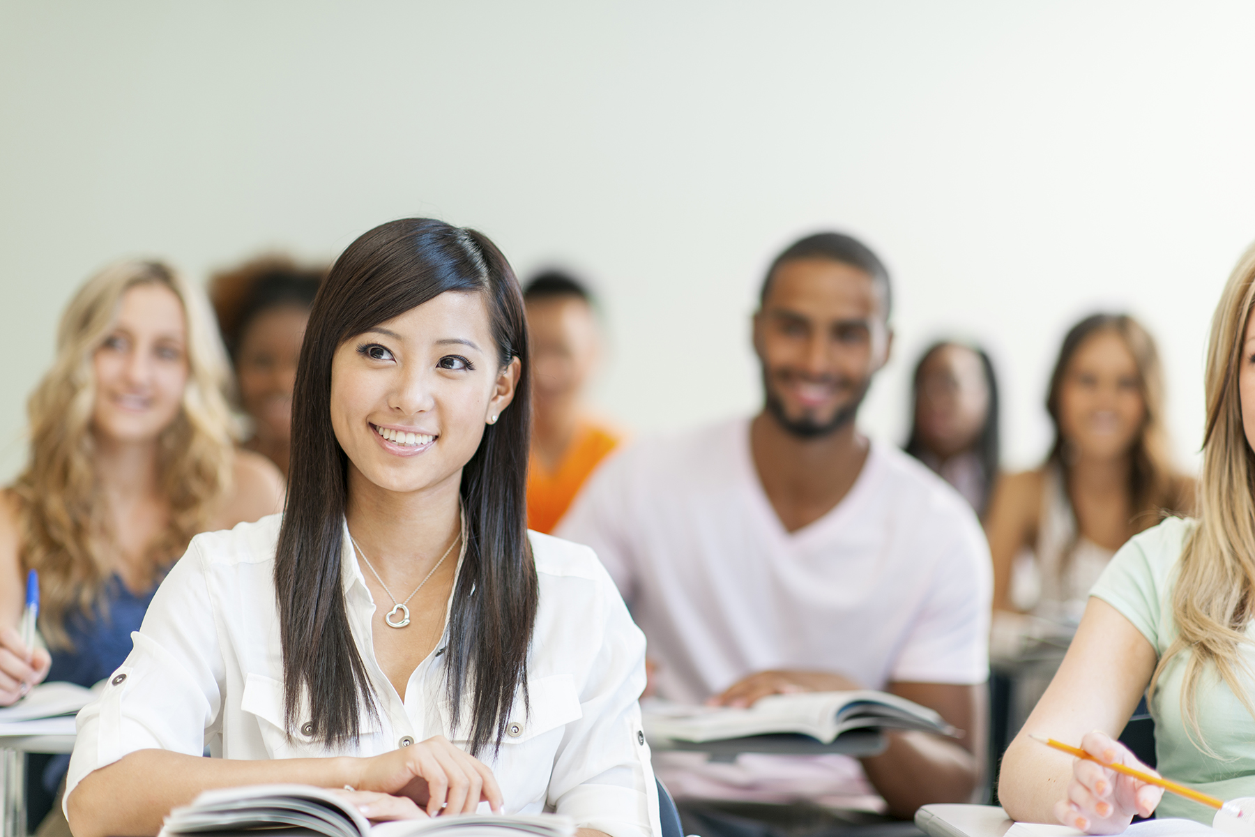 Diverse group of university students in classroom